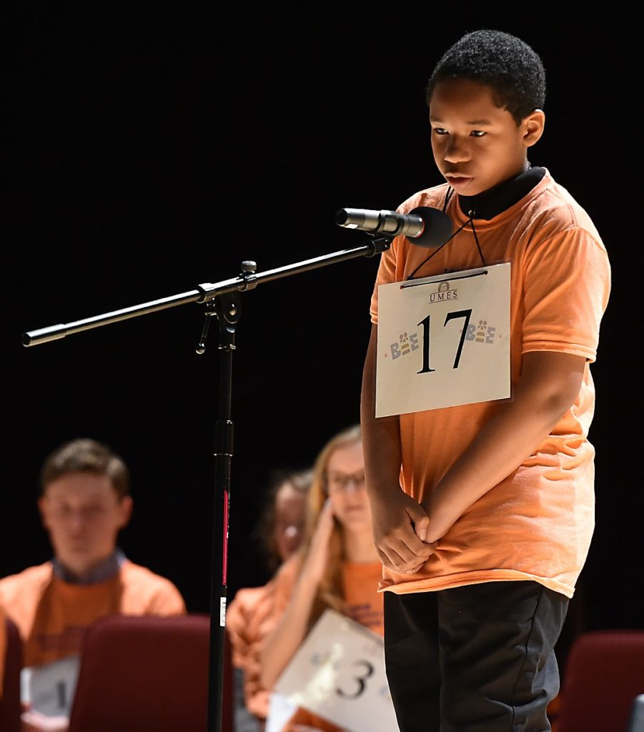 Student at microphone in the spelling bee competition